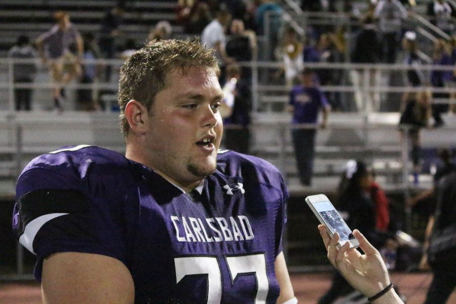 An exhausted Vince Barone answers questions after last Fridays Homecoming crush against Westview. Lancers came out with the win and a final score of 54-7.