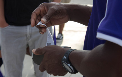 As the students walk onto campus late, administration scans ID-cards and distributes a pass to the students. This is a new system introduced to CHS which discourages students to be tardy.