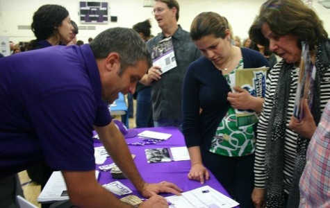 College representatives from Grand Canyon University share important information about potential college options to eager parents. The College and Career Fair held on Oct. 7 welcomed more than 100 colleges and even more representatives.
