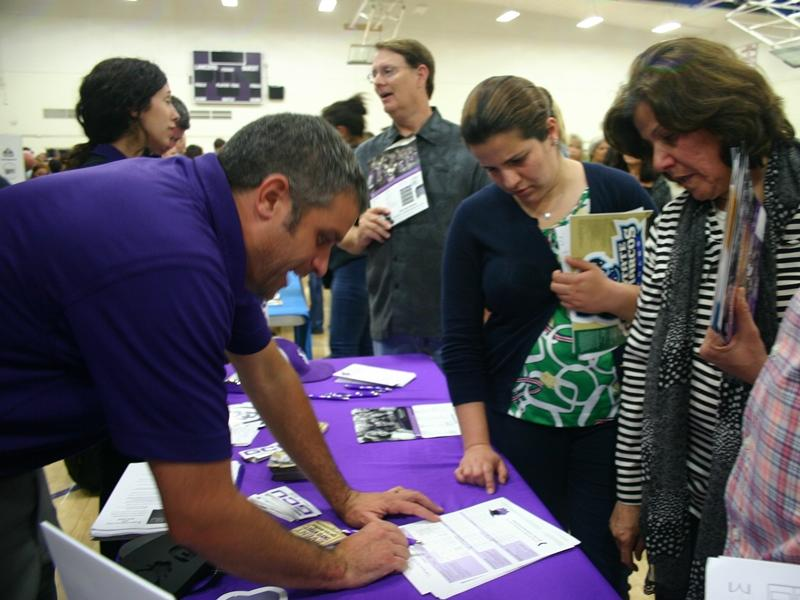 College+representatives+from+Grand+Canyon+University+share+important+information+about+potential+college+options+to+eager+parents.+The+College+and+Career+Fair+held+on+Oct.+7+welcomed+more+than+100+colleges+and+even+more+representatives.