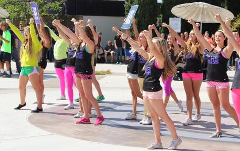 Cheer livens up the campus atmosphere with their performance on Monday. They participated in Neon Day, along with many other students, by wearing as much neon as possible.
