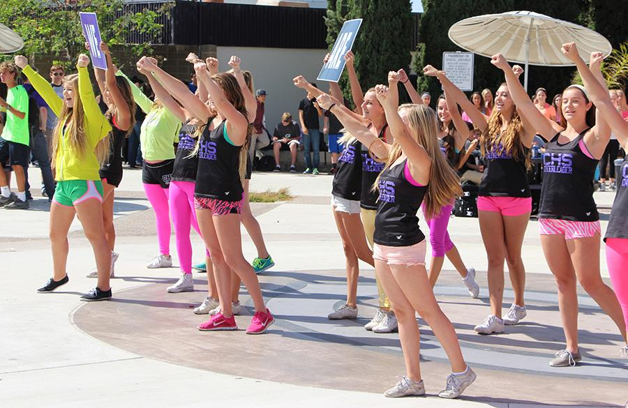 Cheer+livens+up+the+campus+atmosphere+with+their+performance+on+Monday.+They+participated+in+Neon+Day%2C+along+with+many+other+students%2C+by+wearing+as+much+neon+as+possible.+