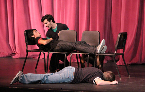Advanced Theater seniors Adam Gilmore, Andrew Patterson, and Evan Ridpath perform an intense scene from their piece at the Theater Showcase on Oct. 22.  At their DTASC competition the following weekend, they won second place out of 54 competitors.