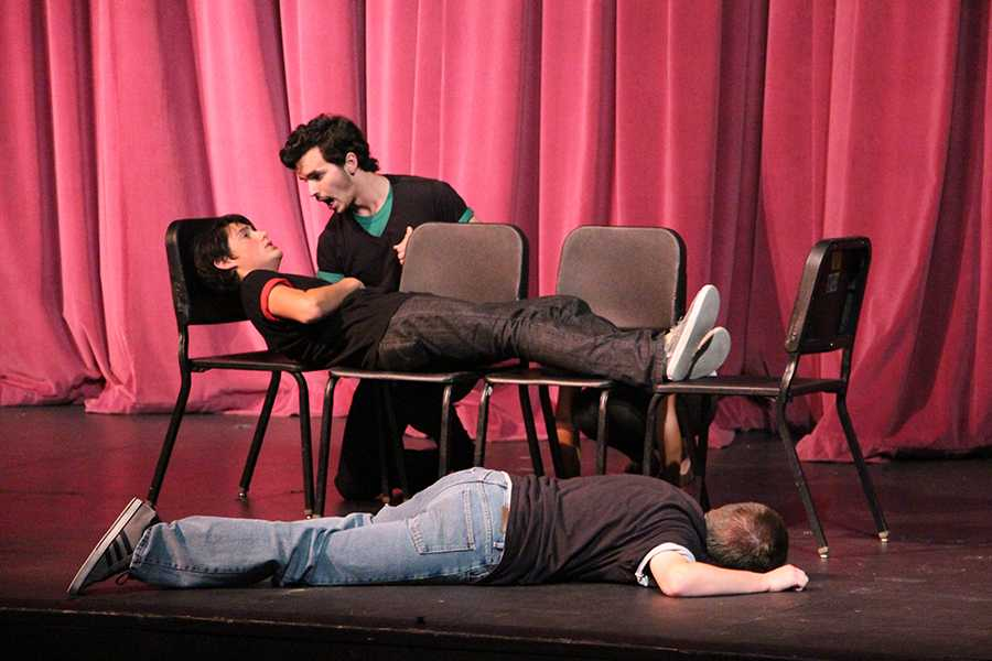 Advanced+Theater+seniors+Adam+Gilmore%2C+Andrew+Patterson%2C+and+Evan+Ridpath+perform+an+intense+scene+from+their+piece+at+the+Theater+Showcase+on+Oct.+22.++At+their+DTASC+competition+the+following+weekend%2C+they+won+second+place+out+of+54+competitors.
