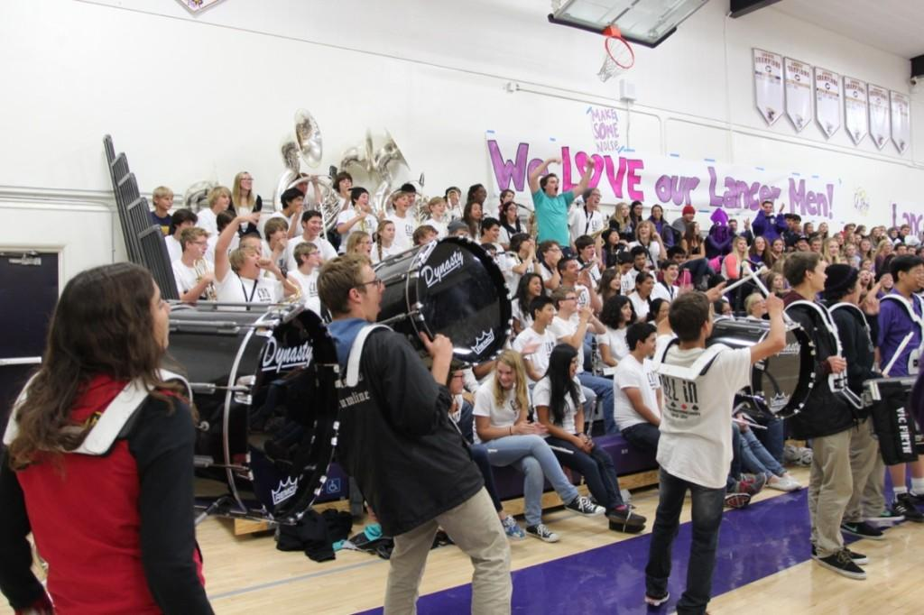 Drumline celebrates after two band members battle it out on the drums. The band was full of spirit even at four in the morning.