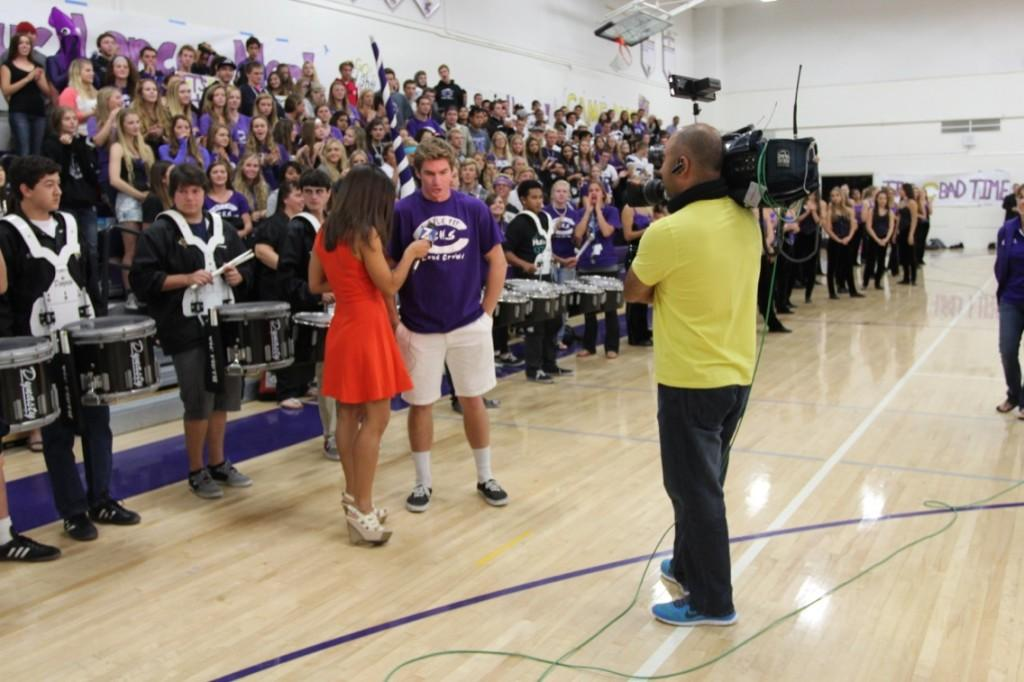Senior Spencer Beyer gets interviewed by NBC news reporter Sherene Tagharobi. The pep rally was held in preparation for the Carlsbad vs. LCC game Friday night.