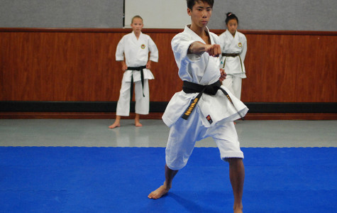 Sophomore Brandon Hong has been involved in karate for over 10 years which proves his passion for the sport. During practice he works on developing his technique along with helping other children in the class.