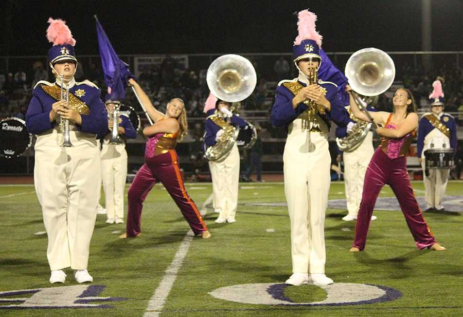 Band and color guard work together during the halftime show to put on a great performance for the audience. Both groups practice everyday during class as well as long hours outside of school.