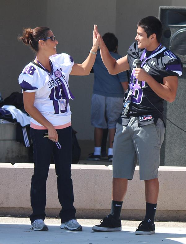 Varsity football player Junior Macedo shows his appreciation for Mrs. Alfonso by giving her his jersey for the Friday night game. At the pep rally the teachers sported their students jerseys giving their support.