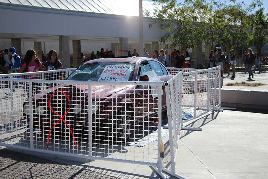 Students take time to read the story on this years Red Ribbon Week car. In 2011, 226 children were killed in drunk driving accidents.