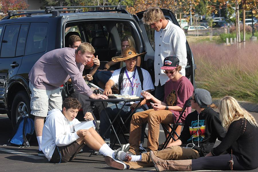 Students from the senior class spend time setting up tailgates when an off-campus lunch cant be arranged. Senior Matt La Bounty keeps small tables in his car for the group to use, as well as various games to stay entertained.