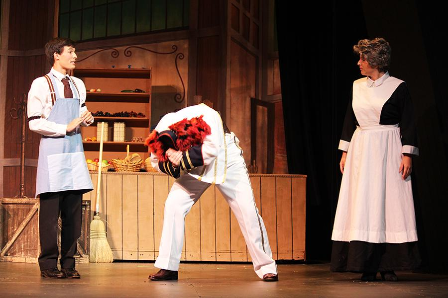 Junior Theo Vance, and seniors Evan Ridpath and Ally Mason take part in an silly scene where Ridpath is forced to stay hidden with his boss' jacket.  The crowd enjoyed watching the outrageousness of the scene.