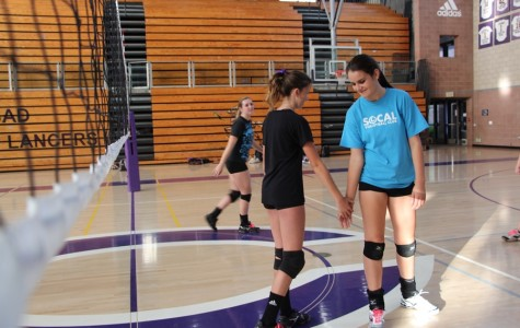 Kelley and Macy show team spirit during practice. JVs last game was on Friday against RBV.