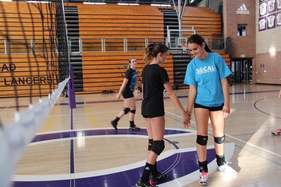 Kelley+and+Macy+show+team+spirit+during+practice.+JVs+last+game+was+on+Friday+against+RBV.