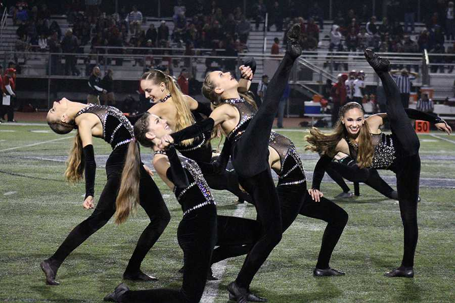 At the home game against Poway, Lancer Dancers wow audiences with their half-time jazz routine. The team works to produce new numbers to perform at each game, while still preparing for their approaching competitions and performances.