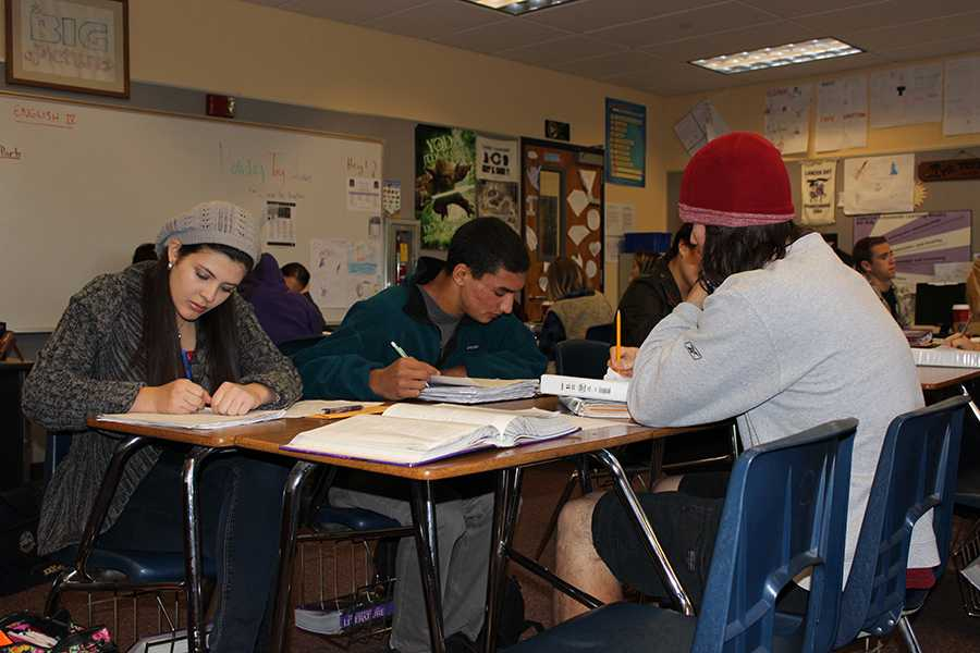 Mr.+Trussel%27s+students+work+hard+in+groups+on+their+writing+assignment.+His+class+is+one+of+the+few+left+at+Carlsbad+that+still+uses+group+tables.