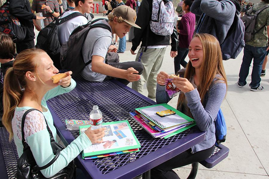 Jordin Shaffer (11) and Milena Barnes (10) share a laugh at lunch. Although it may seem like a bummer for underclassmen to stay on campus, there are many ways to have fun during lunch.
