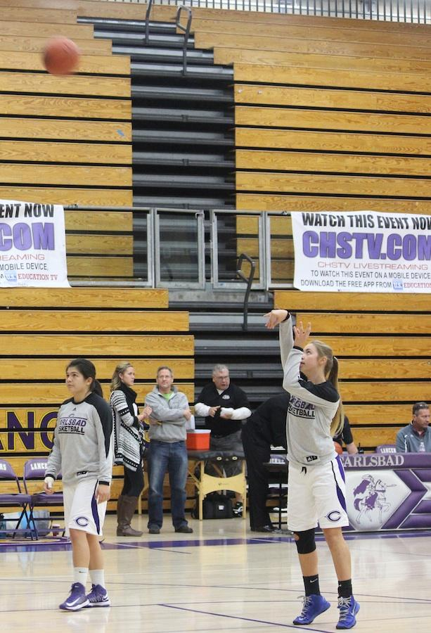 Junior Danielle Bosley shoots a free throw during warm-ups for a game against San Dieguito Academy in the Mr.Harper Invitational Tournament held in the new gym.  Half of the proceeds from the money made during the tournament will be donated to Mr.Harper's children for their college fund.