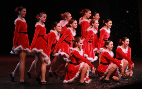 During the finale of the first half of the show, as snow falls from the theatre ceiling, the Lancer Dancers perform their traditional Christmas number to