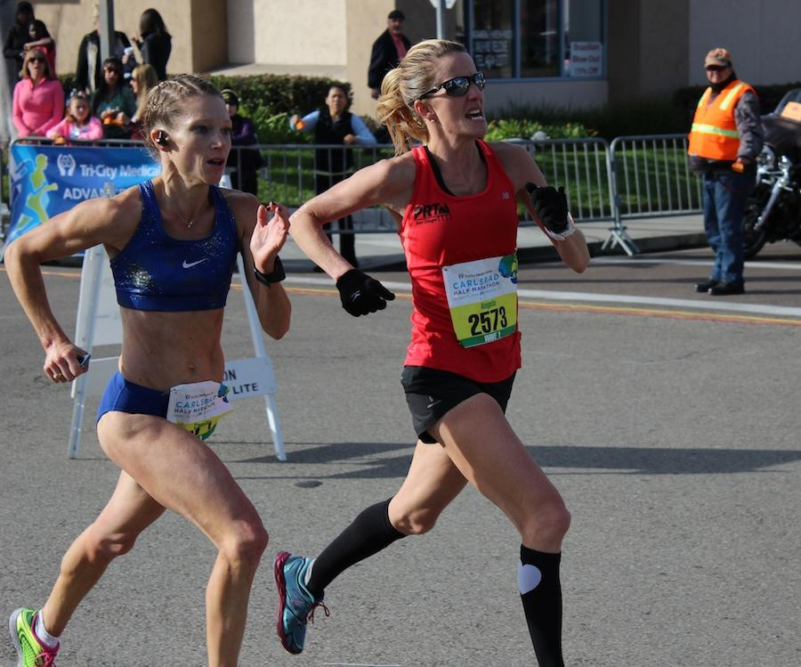 Two women give their final push to the finish line. With such determination shown on their faces, runners like these demonstrated the importance of leading a healthy lifestyle.