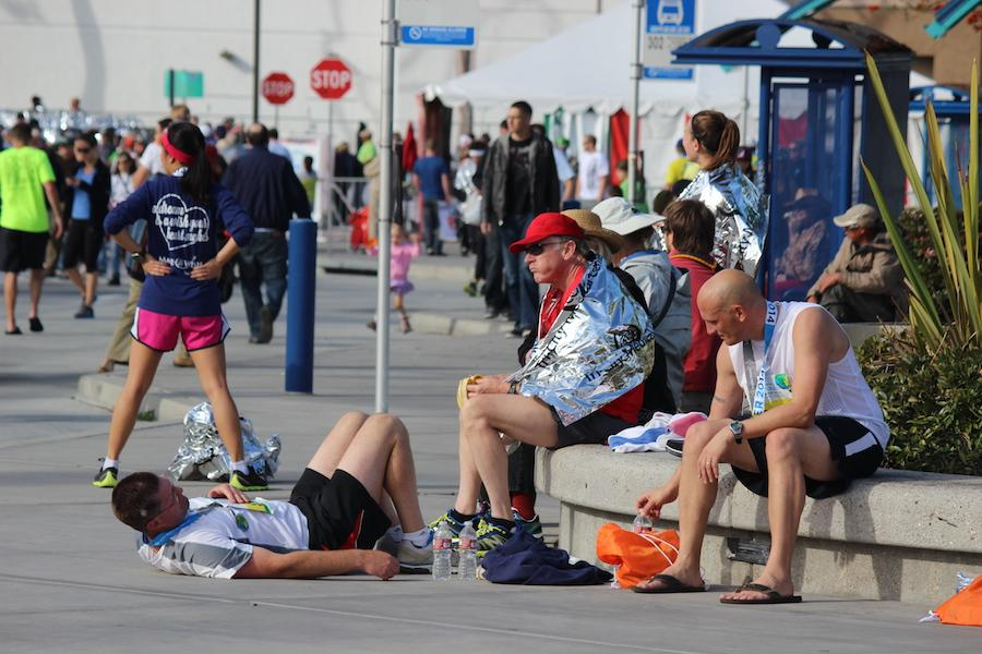 Runners take a rest after completing the race. Marathons are very tough on the body and require months of preparation.