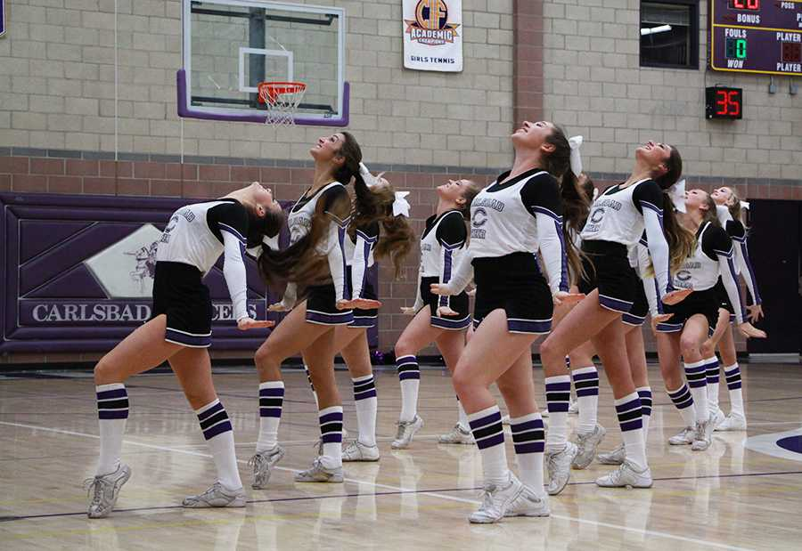 During halftime, the Carlsbad cheerleaders performed their upbeat routine for the crowd to keep up the high energy of the game. Because cheerleaders can no longer stunt on the hardwood floor, they chose to perform a dance routine instead.