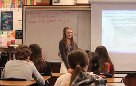 Junior Talia Cain speaks to her fellow creative writers in Creative Writing Club. Creative Writing Club gives students the chance to hang out with one another and write for a good time.