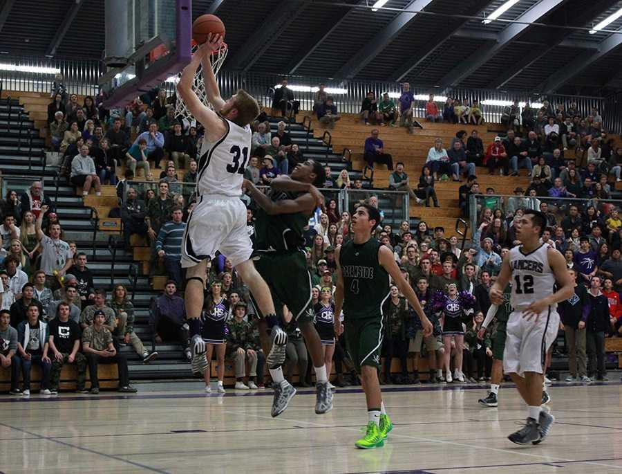 Number 31, Chase Ogden, goes up for a basket during the recent