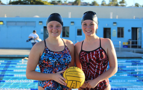 Freshmen Taylor Onstott (left) and Megan Phillips (right) work hard on womens varsity waterpolo. The varsity team has won seven games and continues to prepare for CIFs.