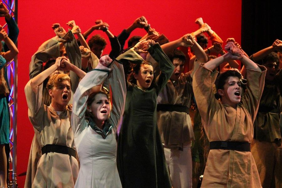 Sound Express, the advanced mixed show choir, performs their Robin Hood-themed set that illustrates the battle between rich and poor. Night With the Stars features numerous competition sets similar to this one, all varying in theme, that the choir groups perform in addition to solo or group acts throughout the show.
