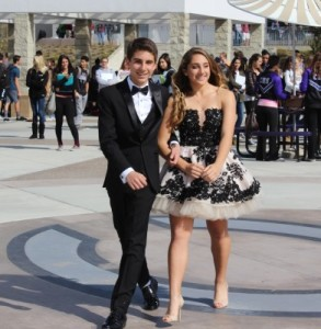 Freshmen Noah Nasser and Alexis Mertz model their formal attire at the pep rally on Friday. Students in ASB put together a fashion show to give students an idea of what to wear to formal March 1st.