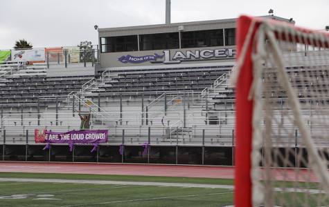 Fans rally together to support their fellow Lancers at a lax game. Crowd support is huge, the team is excited about this record making turn out. (Photo Illustration)