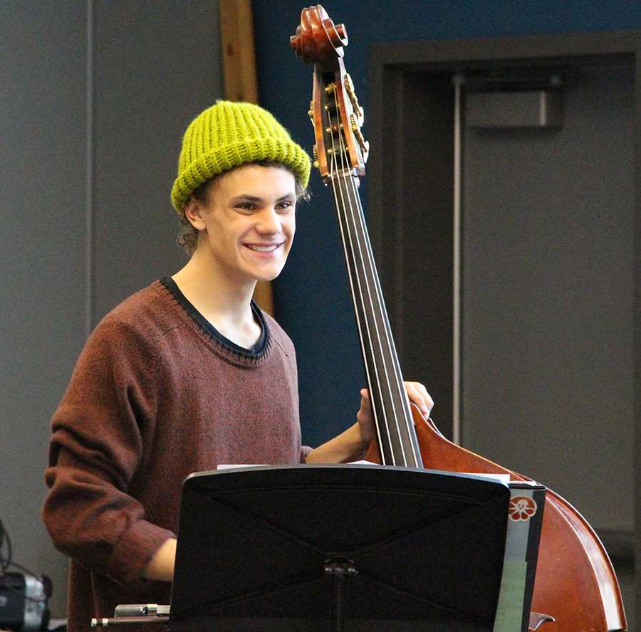 Brock+Steussi+shows+his+pearly+whites+while+sharing+a+laugh+in+orchestra+class.+Brock+works+extremely+hard+in+and+out+of+the+classroom+on+schoolwork+and+the+bass.