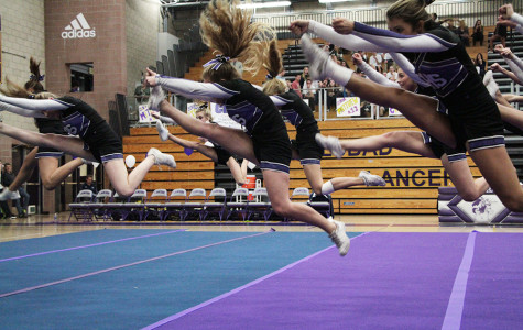 At halftime of Friday night's basketball, cheer performed their routine on mats. Recently, the cheerleaders were told they couldn't tumble during their routines on the wooden gym floor, but not wanting to sacrifice what they'd worked hard on, they compromised with the mats.