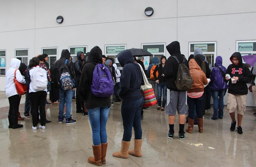 Students wait in line to get food from the campus cafeteria. Freshmen and Sophomores must stay on campus at lunch.