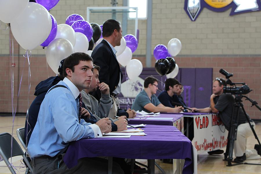 Senior James Carver gazes into the crowd during the signing. Parents, students, and facility attended to share this special moment with the football players.