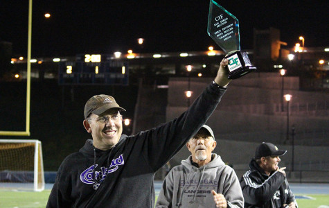 Head Coach Riccitelli victoriously shows off the CIF Championship trophy. This is the boy's varsity soccer team's first CIF open division win in Carlsbad history.