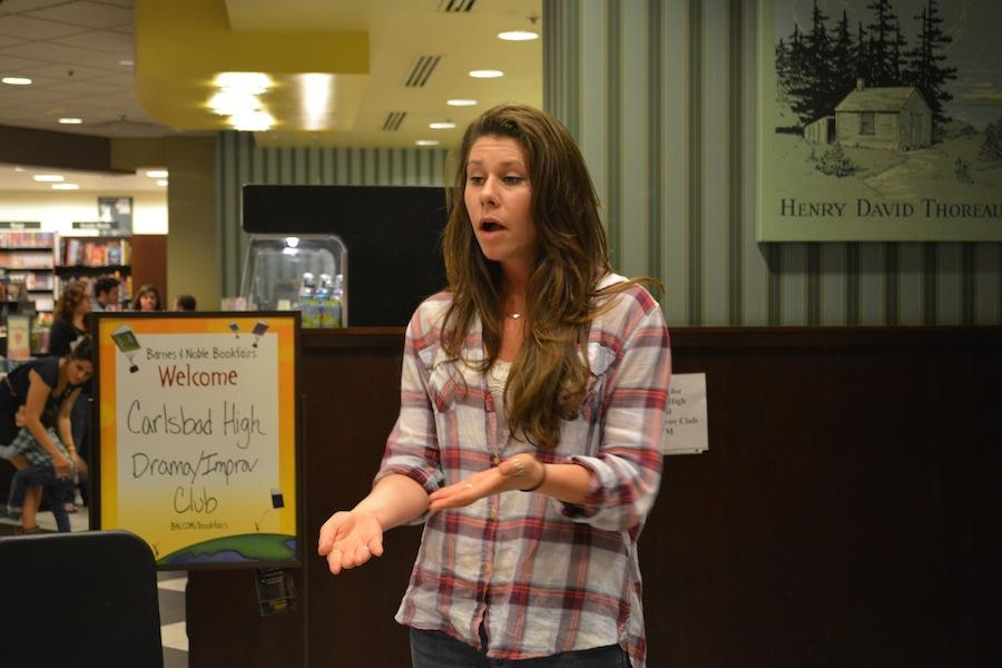 Senior Alexa Harris performs at Drama and Improv Club's Coffee House Night at Barnes and Noble fundraiser on Wednesday night. The proceeds from the night and sales throughout the week will benefit the theatre department.