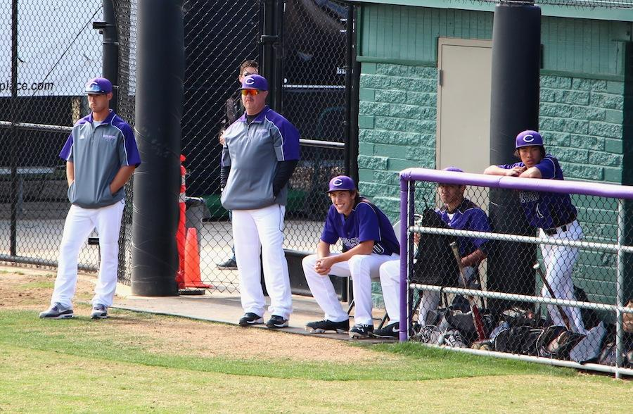 Boys+varsity+coach+%22Monty%22+Montgomery+looks+on+alongside+the+assistant+coach+and+juniors+Ethan+Emery+and+Gary+Lao.++Monty+started+coaching+baseball+seventeen+years+ago+and+has+never+looked+back.