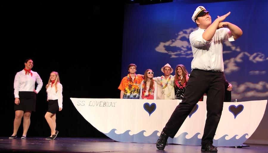 Junior Andrew Eason signs along to the tune USS Loveboat during Wed. Mar. 26s performance of the ASL Happening Hands Show.  Proceeds from the show go to scholarships for deaf and hard of hearing students at CHS.