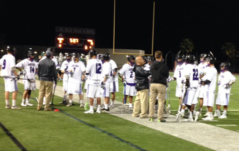 Mens lacrosse players bring it in for a timeout huddle at the game Friday. Lancers lost 9-6 to Poway High School.