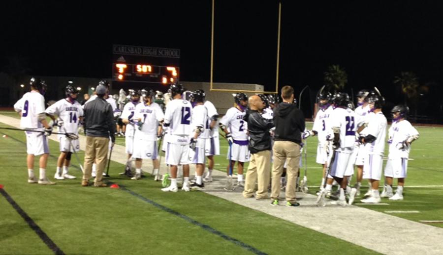 Mens+lacrosse+players+bring+it+in+for+a+timeout+huddle+at+the+game+Friday.+Lancers+lost+9-6+to+Poway+High+School.+