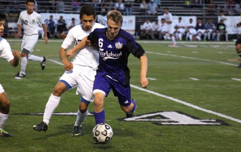 Starting the second half, senior Ethan Cowling manages to keep the ball away from Birmingham defenders.