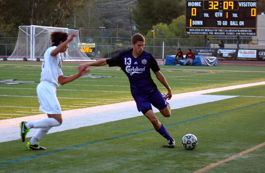 Varsity soccer member Garrett Snyder faces a defensive player from Birmingham High School on Thursday night in the CIF state semifinals game in Calabasas. The team ended with a 1-0 victory an will advance to the state finals on Saturday night.