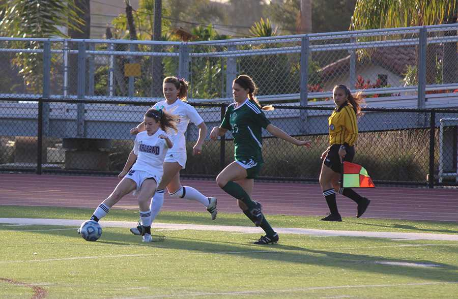 Sophomore Summer Mason defends the ball from her LCC opponent during the CIF semi finals. Unfortunately the girls lost their game 1-0 but had an excellent season.