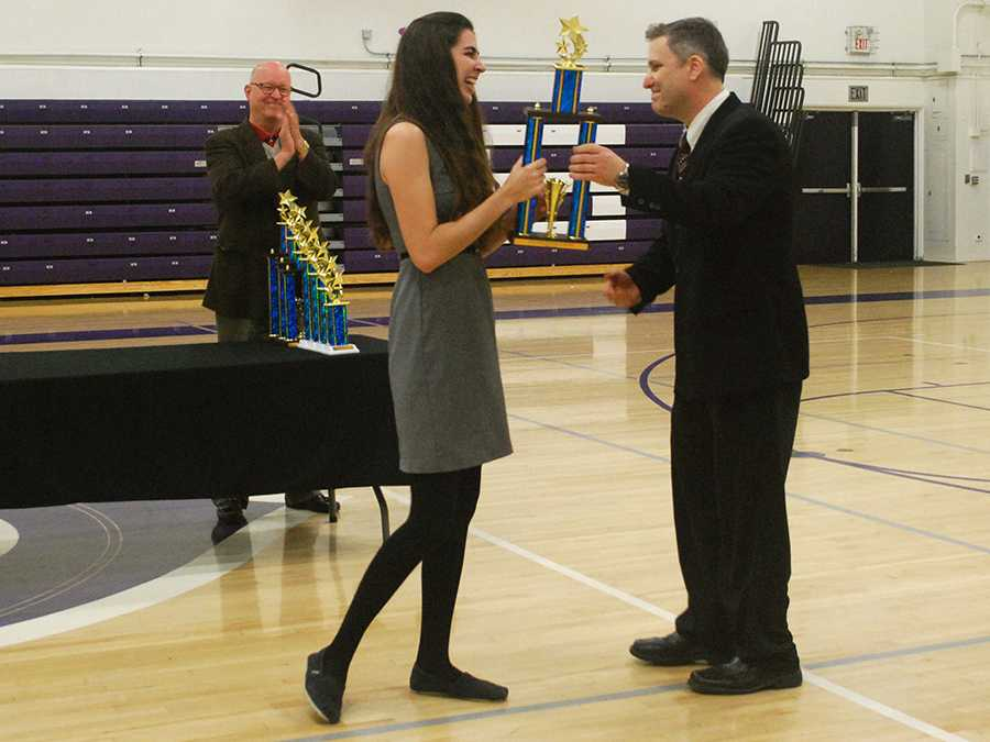 Kallan+Arkeder+accepts+her+first+place+in+Original+Advocacy+at+the+Speech+and+Debate+State+Qualifying+tournament.+The+finals+will+be+in+Modesto+from+April+25-27.