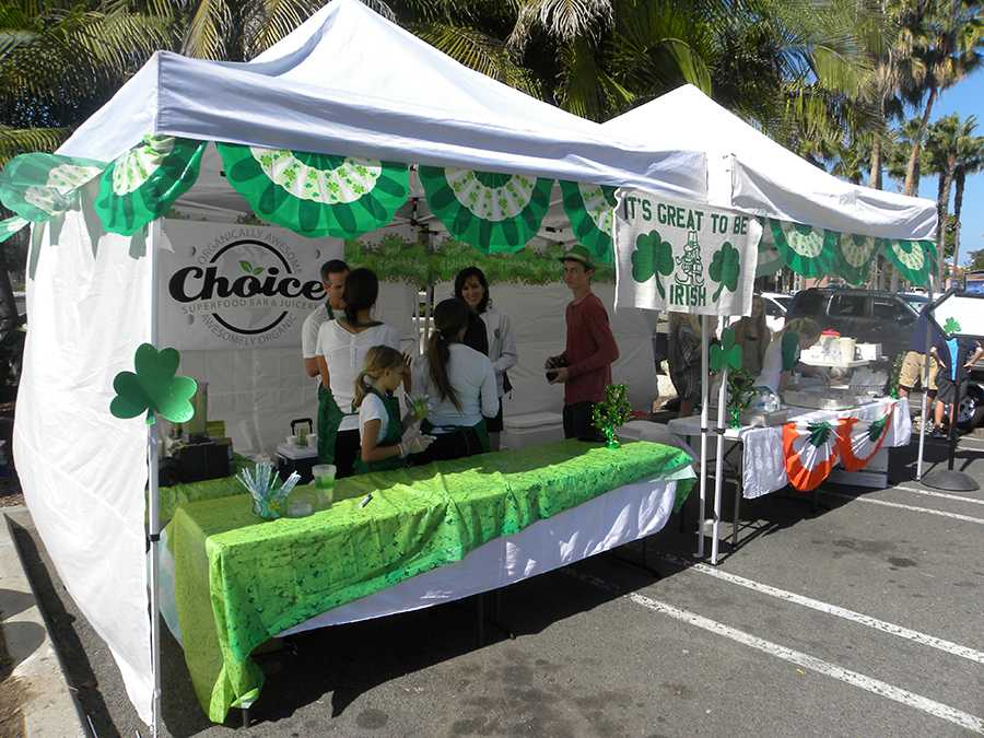 Volunteers work under a decorated tent at the St. Patricks Day brunch on March 15th. The Carlsbad Hi-Noon Rotary Club planned the event to raise funds for scholarships for CHS students.