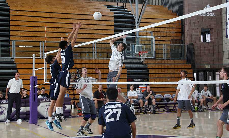 Senior Taylor Bloomquist goes up for a kill during his game against Kamehameha. This was the Lancers first game of the season. They won after the fourth game.