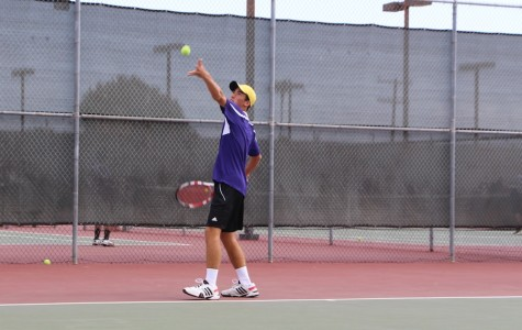 Senior Chad Stone warms up his serves during a game against Mission Hills.  Chad has been playing tennis since he was six years old and also play piano while keeping a rigorous academic schedule.