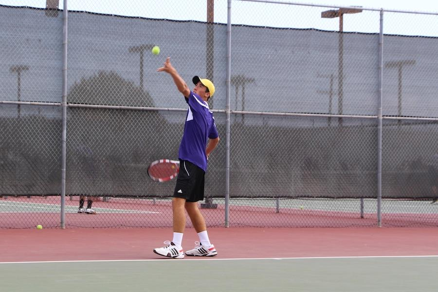 Senior+Chad+Stone+warms+up+his+serves+during+a+game+against+Mission+Hills.++Chad+has+been+playing+tennis+since+he+was+six+years+old+and+also+play+piano+while+keeping+a+rigorous+academic+schedule.